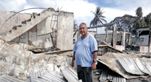 DAR founder Charles Domnick stands outside the former Israeli Consulate office, part of the fire-destroyed DAR complex. Photo: Hilary Hosia.