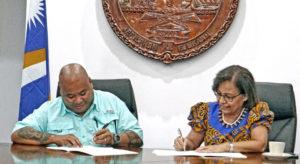 MICNGOs President Alson Kelen, left, and RMI President Hilda Heine signed the first-ever Partnership Framework Agreement for civil society last week in Majuro. Photo: Hilary Hosia.