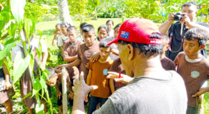 """Laura resident Jabukja Aikne talked to Woja Elementary students last week about the """"what, how and why"""" of successful farming in Majuro. Photo: Kelly Lorennij."""