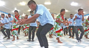 Marshalls Christian High School student Balaan Langidrik leads the spirited jepta from Rongrong Island during a performance at Uliga Protestant Church Christmas night. Photo: Hilary Hosia.