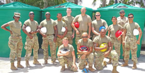 Pacific Partnership's US Army team at Long Island Elementary School where they installed water catchments for students and teachers. At right, standing, is Marshallese Sgt. Joseia Lemari. Photo: Hilary Hosia.
