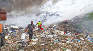 Majuro Atoll Waste Company workers used a bucket brigade to try to contain the fire at the dump March 8. Photo: Hilary Hosia.