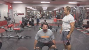 Scott Williams working on squat curls with Stewart.""