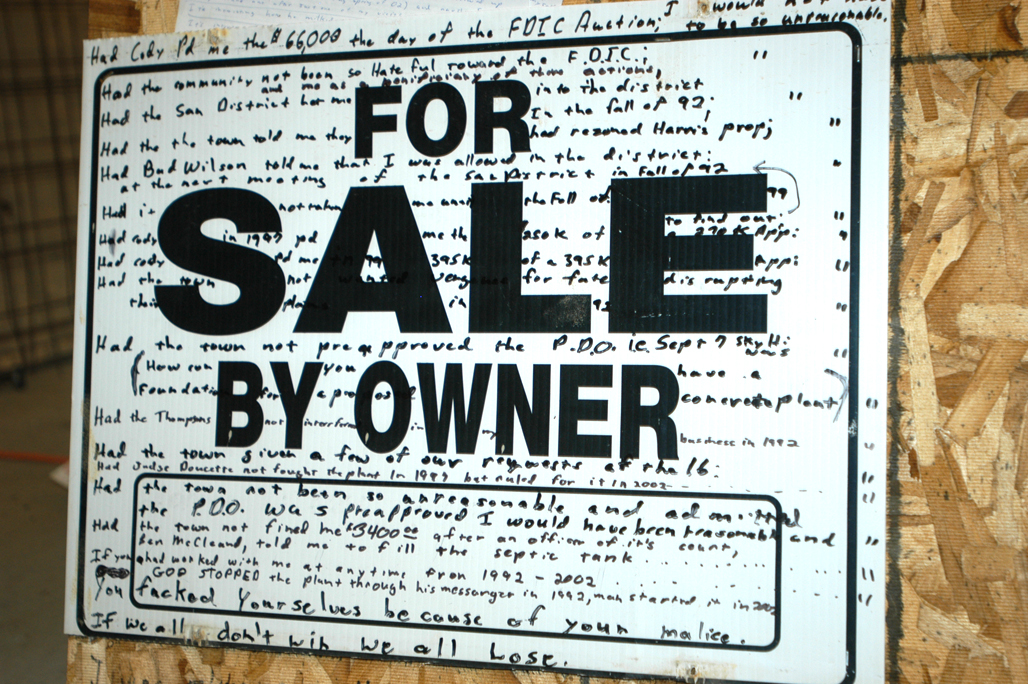 shows Marv's sale sign