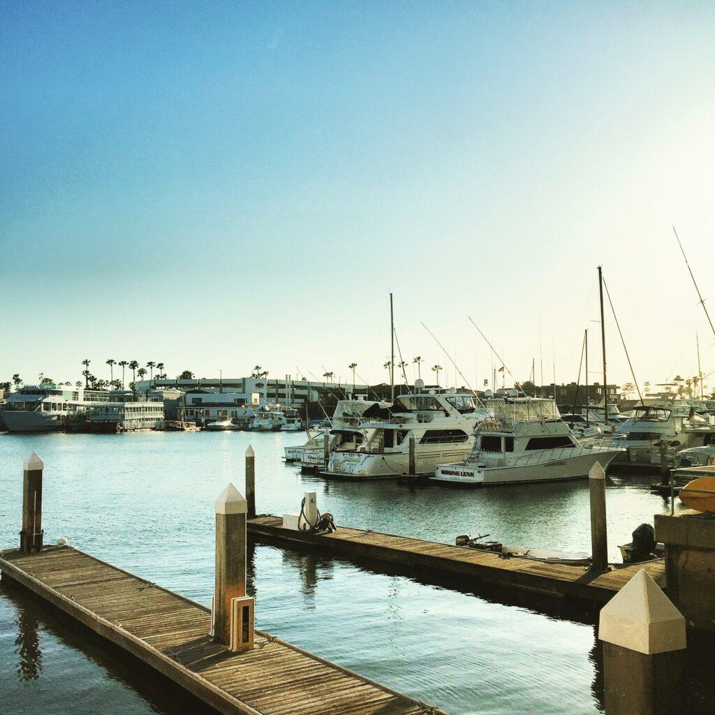 Boats docked on the Balboa Peninsula waterfront.