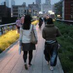 Two best girl friends walking together on the Highline in NYC contemplating and reflecting on life in general together, knowing that life is better with each other