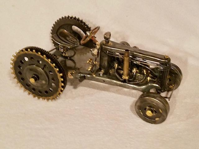 John Sokolovich. # 139 Pappys tractor Sculpture $250.