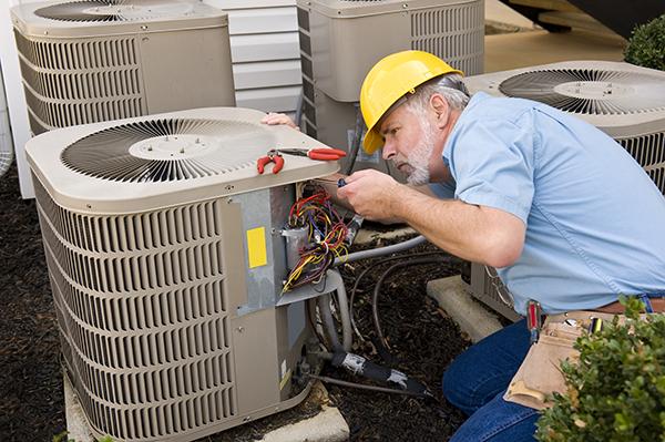 Hvac tech checking refrigerant
