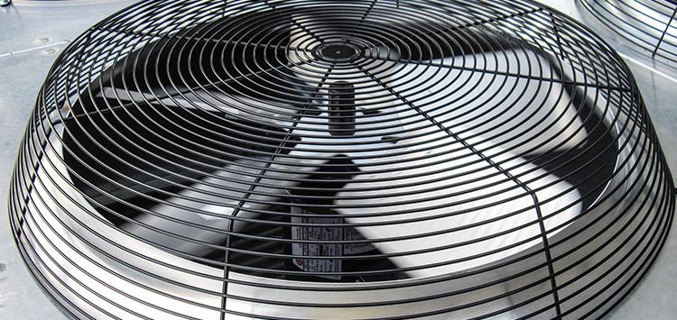 AC condenser fan blades spinning