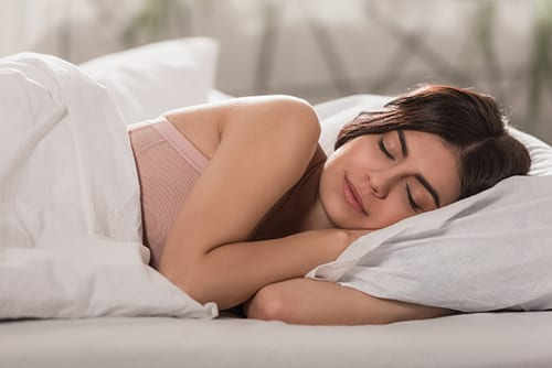 Girl sleeping on bed in cool home