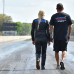 Andie and Chad taking a walk before making a test pass at Their hometrack track. Orlando Speedworld Dragway