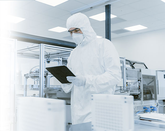 A photo of a lab technician holding a tablet