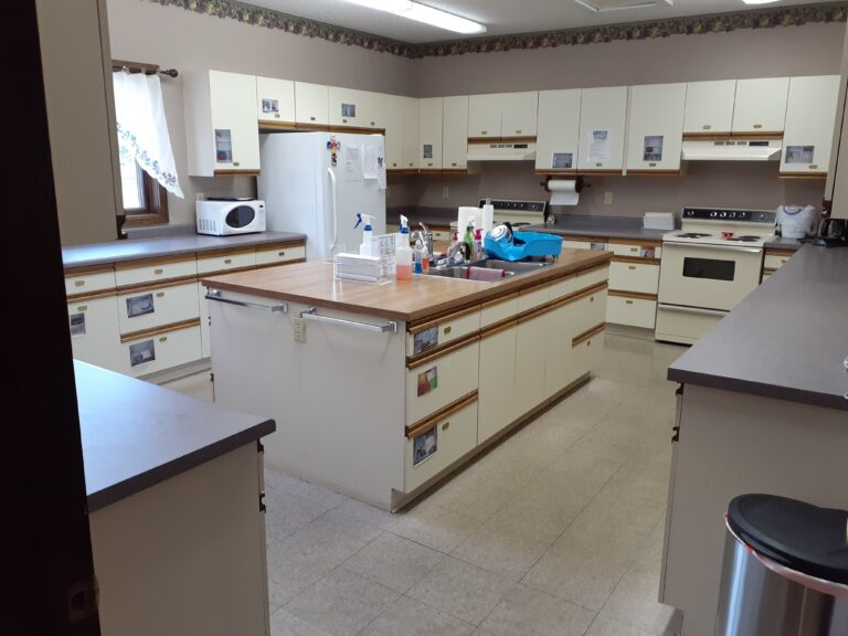 Kitchen big enough for preparing and/or serving meals