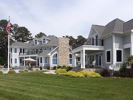 white stone waterfront home