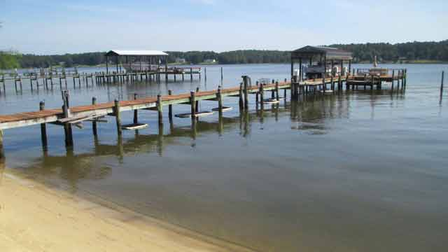 pier with oyster harvesting containers