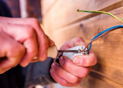 hands-of-unrecognizable-electrician-working-with-P4GSHKQ