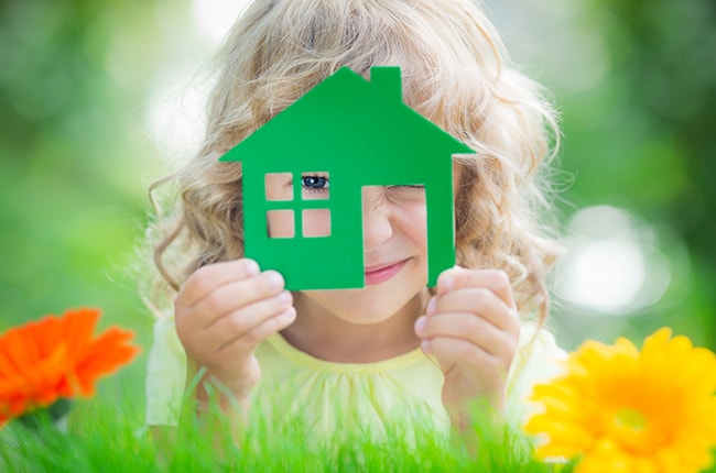 Girl in Georgia with a green toy house