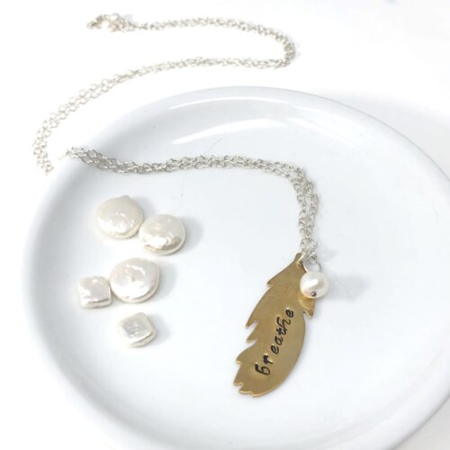 Handstamped feather in brass with pearl charm