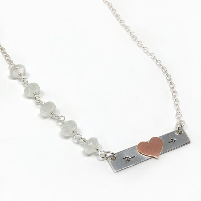 Silver bar necklace with heart initial and gemstones.