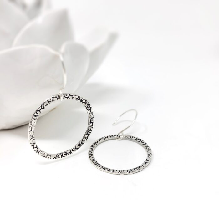 Sterling silver hoop earrings. Connection collection.