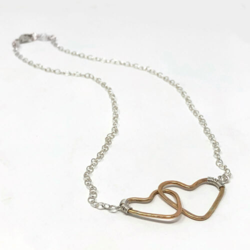 Connecting hearts in gold and silver