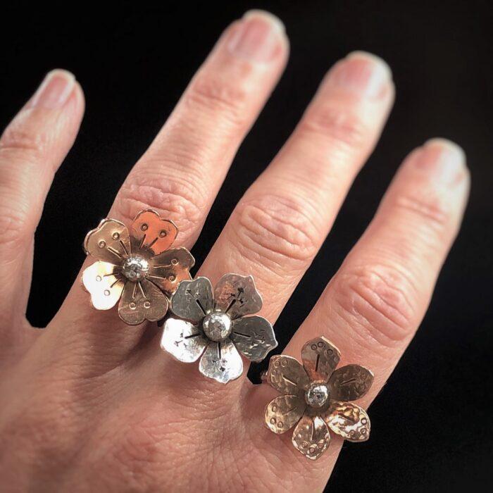 flower rings on hand
