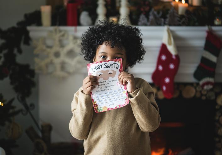 Kid with Christmas wishlis