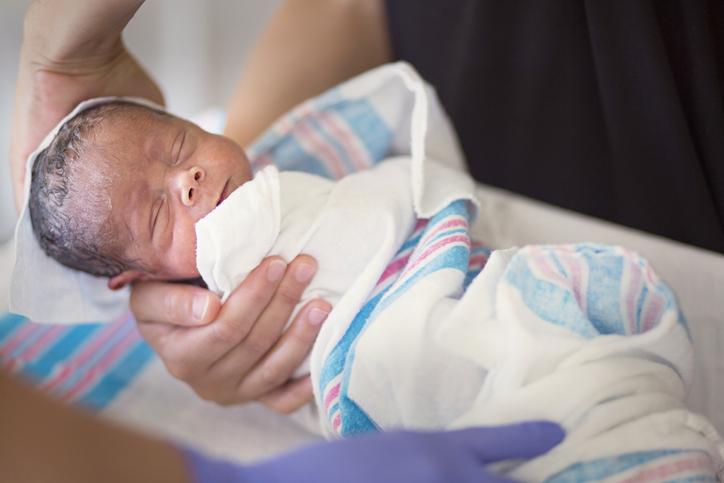 Mother holding her newborn premature bab