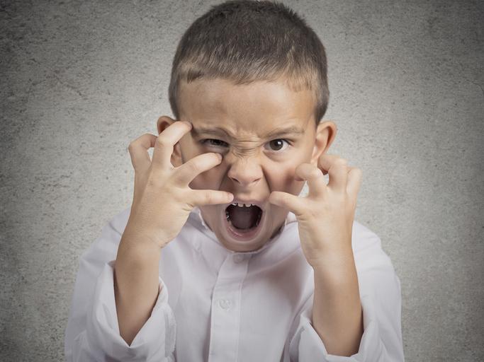 Closeup portrait angry child