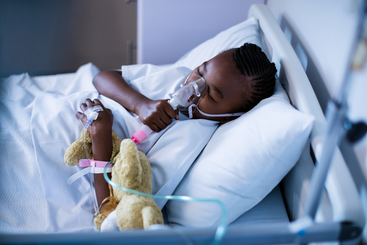 Patient wearing oxygen mask while sleeping