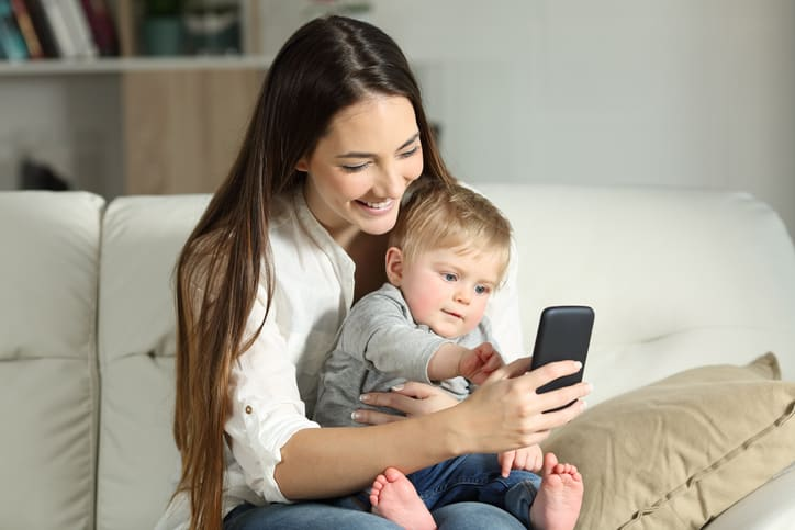 Mother and baby playing with a smart phone