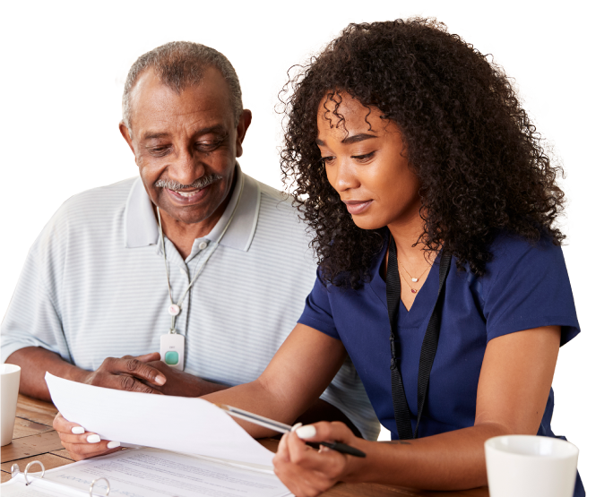 Healthcare worker helping a patient with paperwork