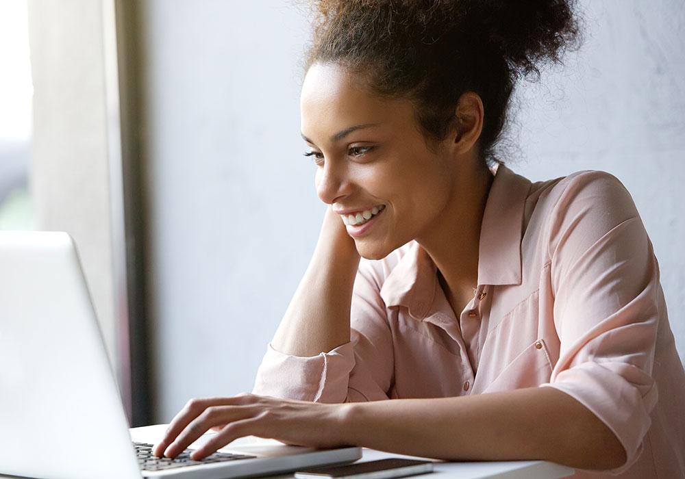 woman looking at laptop computer