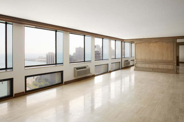 The current living room stretches 80 feet. That's  80' of prime lakefront views.