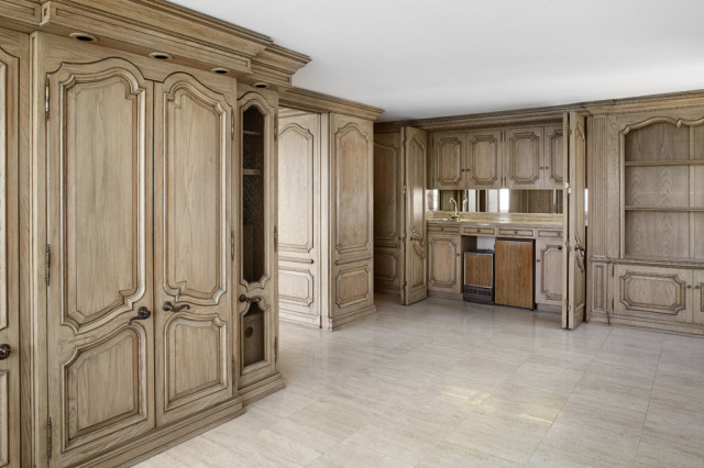 There is beautiful custom-built-in heavy oak cabinetry in the Penthouse.