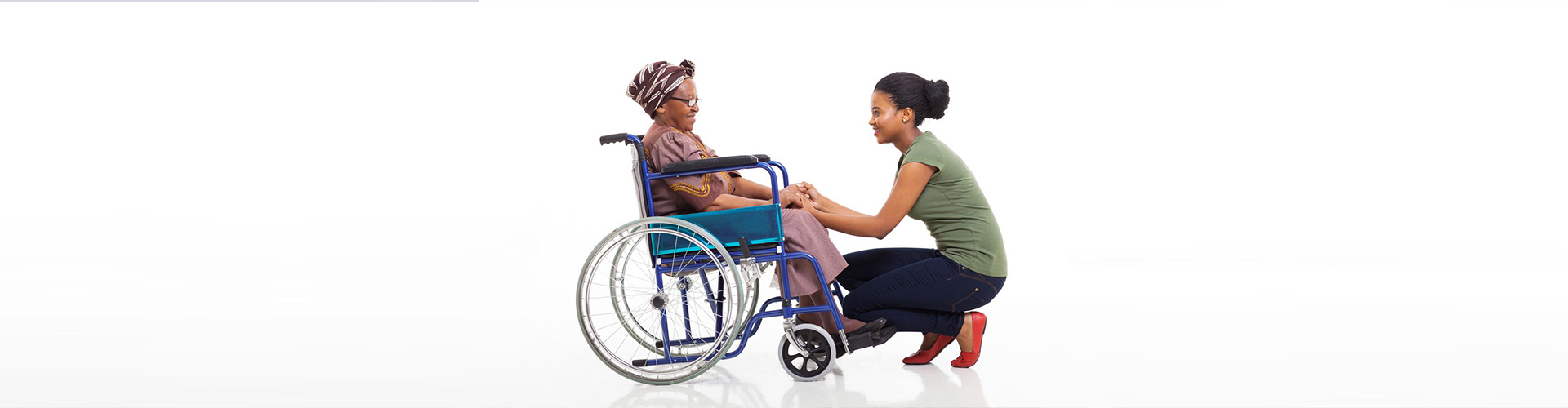 lady in front of old woman in wheelchair