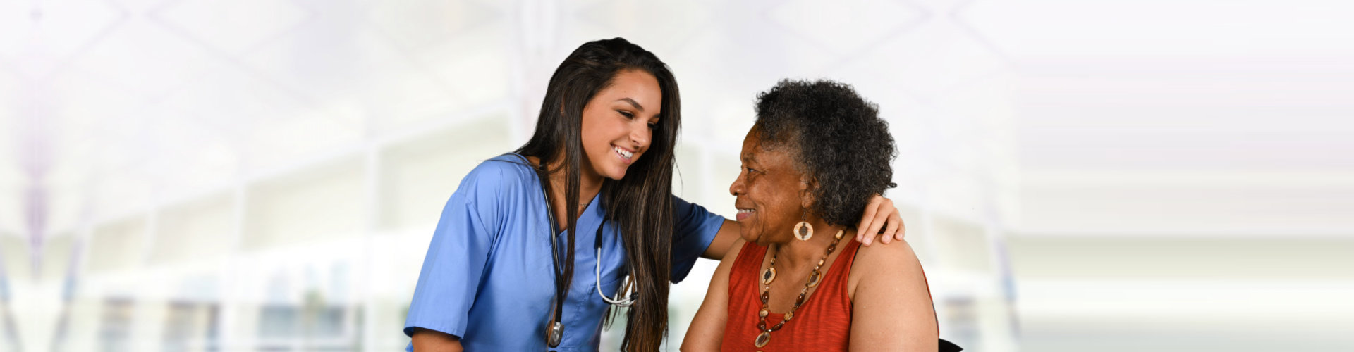 caregiver and elder woman looking at each other