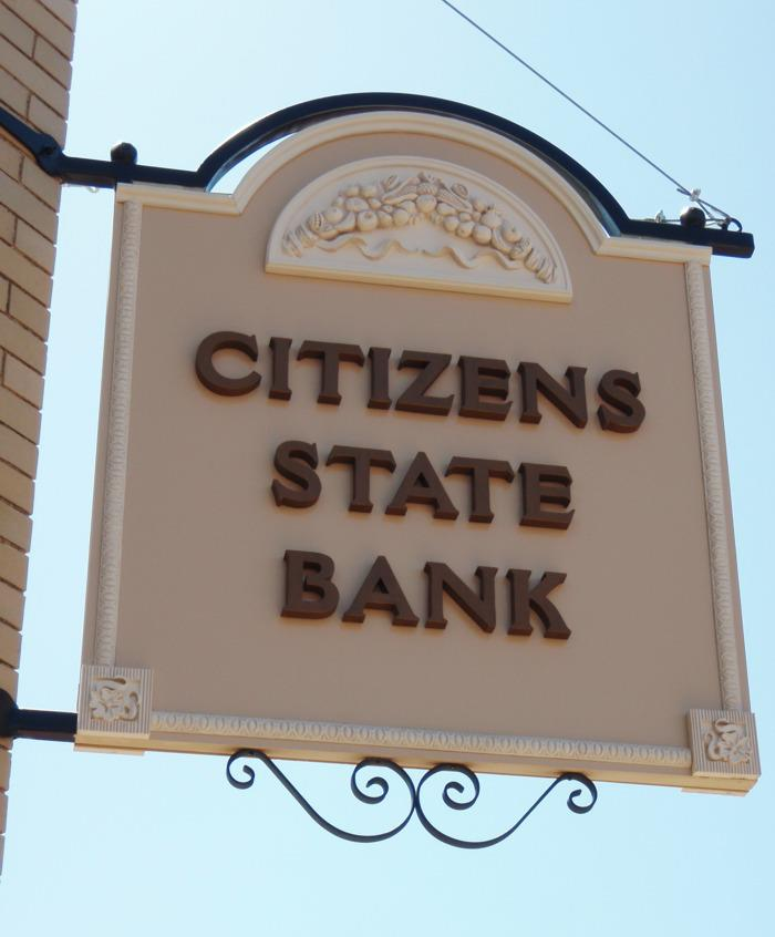 Citizens State Bank Post-install with custom metal scroll work.