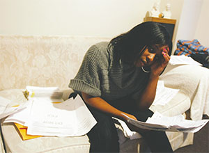 JuWanda Harris holds personal documents on Feb. 17, 2010, in Chicago. After Harris filed her tax return, the IRS told her someone using her Social Security number had already filed a return. (PHIL VELASQUEZ/CHICAGO TRIBUNE/TNS)