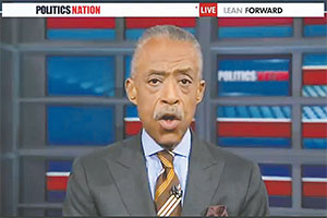 A federal lawsuit says the Rev. Al Sharpton's MSNBC talk show, 'Politics Nation,' serves as a $750,000 yearly payoff for his continuing support of a proposed $45 billion corporate merger involving Comcast, which owns MSNBC – Sharpton's 'boss.' (COURTESY OF MSNBC)