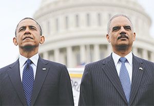 President Obama and Attorney General Eric Holder attended the 32st Annual National Peace Officers' Memorial Service in Washington, D.C. in 2013.(OLIVIER DOULIERY/ABACA PRESS/MCT)