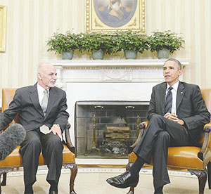 President Obama spoke to Afghan President Ashraf Ghani during a White House meeting on Tuesday. Ghani's election in 2014 marked the first democratic transfer of power in Afghanistan's history. (OLIVIER DOULIERY/TNS)