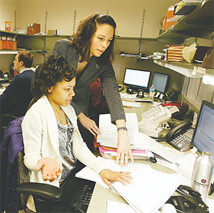Jessica Gatzke, right, senior manager at Scribner and Cohen and Co. accounting firm, helps University of Wisconsin–Milwaukee intern Lana Jamerson prepare taxes on March 20, 2014.(GARY PORTER/MILWAUKEE JOURNAL SENTINEL/TNS)