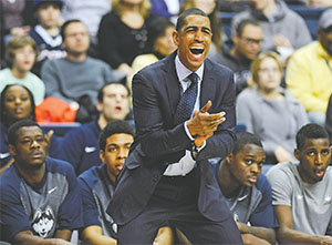 University of Connecticut Head Coach Kevin Ollie is one of a handful of African-American who are coaching big-college basketball teams.(JOHN WOIKE/HARTFORD COURANT/TNS)