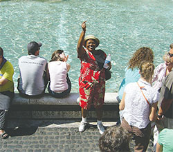 The author's sister, Valerie, throws a coin into the Trevi Fountain.