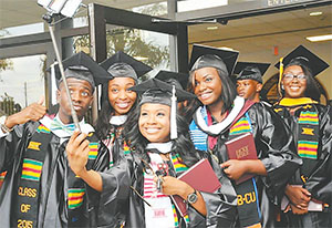 Selfie-stick users put smartphones and cameras on the ends of poles to extend their reach, frequently capturing theme-park moments through self-portraits. This selfie, using the stick, was taken earlier this year at a Bethune-Cookman University commencement.(File Photo)