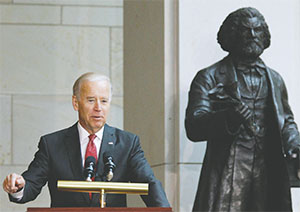 Vice President Joe Biden speaks during a ceremony honoring Frederick Douglass in front of a statue of Douglass inside the U.S. Capitol in Washington June 19, 2013. (MOLLY RILEY/MCT)