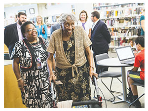 Pearl Thompson approaches the checkout desk before receiving the library card she was denied decades ago.(PHOTOS BY TRAVIS LONG/RALEIGN NEWS & OBSERVER/TNS)