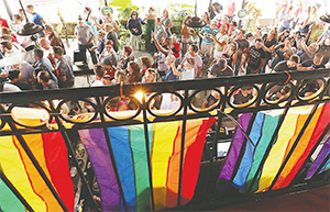 Hundreds of supporters gather during a party at the Hammered Lamb bar in Orlando to celebrate the U.S. Supreme Court ruling allowing gay marriage nationwide on June 26.(STEPHEN M. DOWELL/ORLANDO SENTINEL/TNS)