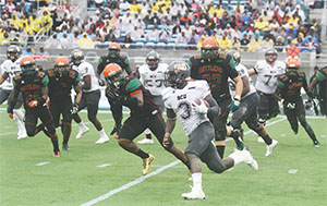 The Florida A&M Rattlers try to stop Bethune-Cookman University quarterback Quentin Williams during the 2014 Florida Classic in Orlando. This year's game is Nov. 21 at the Florida Citrus Bowl.(FILE PHOTO)
